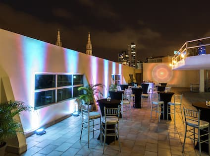 Space Set up for Event on Hotel Rooftop at Night
