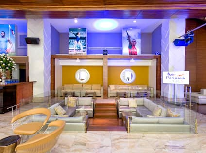 Lobby with sunken seating area, sofas and Olympic posters featured on the walls