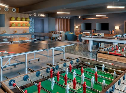 Hotel Game Room with Foosball and Ping Pong Tables