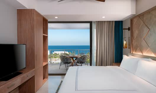 Guest Room with Large Bed and Balcony with Seating Area with Ocean View