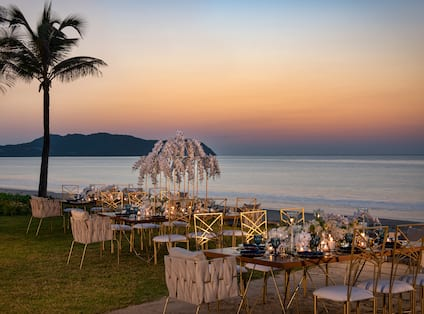 Outdoor Wedding Reception by the Water at Sunset