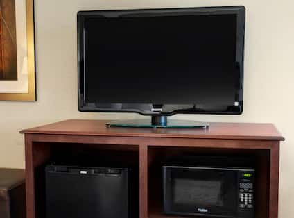 Guest Room TV Cabinet Microwave and Mini Fridge