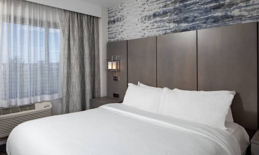 Bed in room with radiator