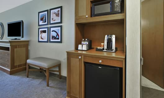 Fridge in bedroom with tea and coffee making facilities