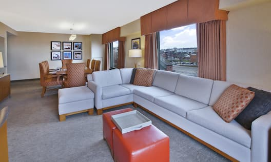Large couch in suite with dining area