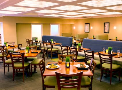 Tables, Chairs, and Booth Seating in Restaurant Dining Area