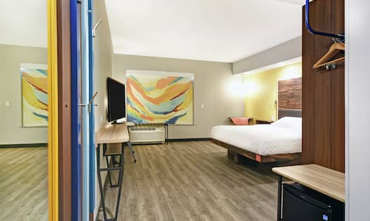 Accessible Guestroom with King Bed Television and Mini Fridge