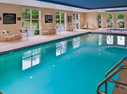 Indoor Swimming Pool with Seats and Tables