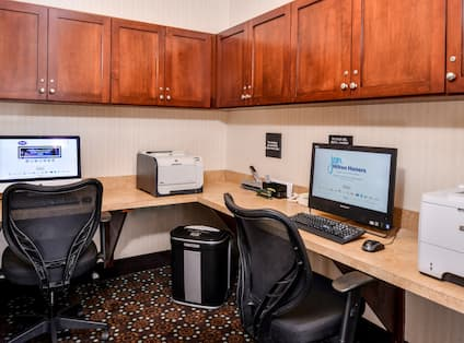 Business Center with Two Desktop Computers, Two Printers and Two Computer Chairs