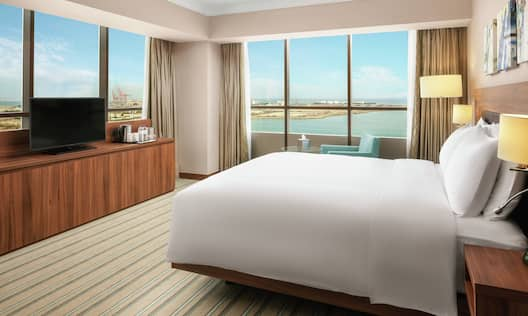 Corner Guestroom with Bed, Room Technology, and Outside View
