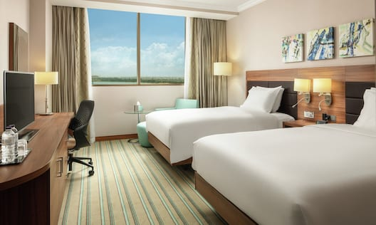 Twin Guestroom with Two Beds, Lounge Area, Outside View, Work Desk, and Room Technology