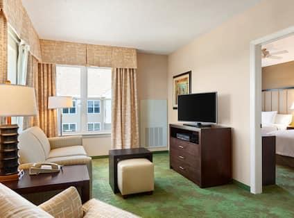 Living Area in 1 King, 2 Queen Suite