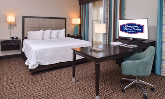 Guestroom with King Bed, Work Desk and Television