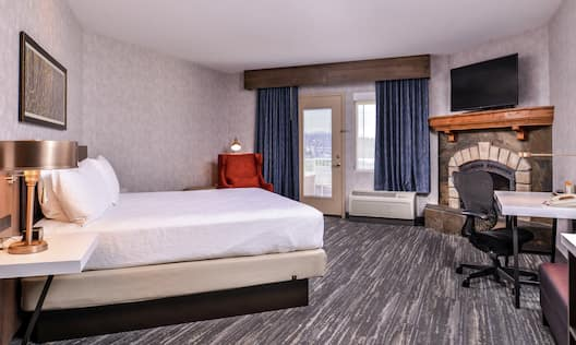 King Deluxe Room with Balcony and Fireplace