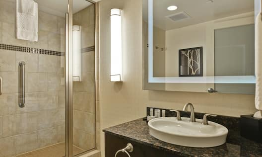 Bathtub with sink, mirror and shower