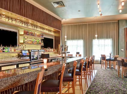 Restaurant with TV, barstools and seating