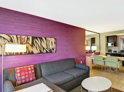 Lounge area with purple wall and comfortable seating