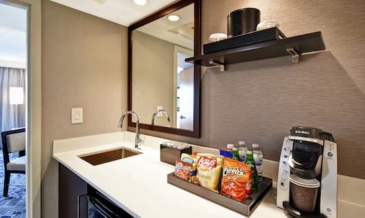Guestroom Wetbar With Keurig And Snack Tray Amenities