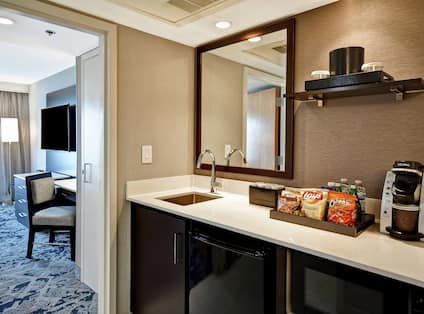 Guestroom Wet Bar With Keurig And Snack Tray Amenities