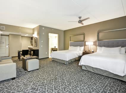 Two Queen Beds and Lounge Area in Studio Suite