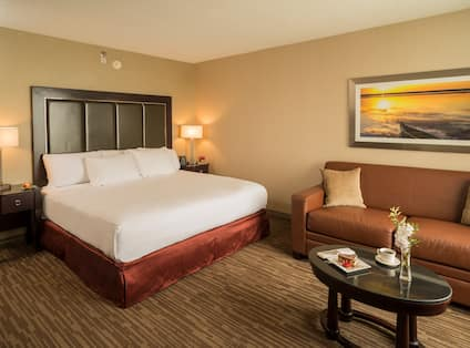 Bed in room with couch and table