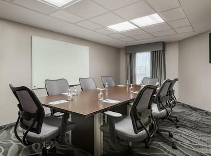 Homewood Suites Raleigh-Durham AP/Research Triangle Hotel, NC - Boardroom with meeting table, chairs and presentation board