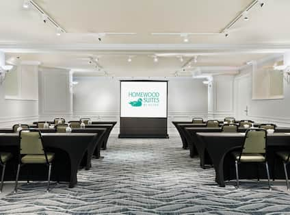 Homewood Suites Raleigh-Durham AP/Research Triangle Hotel, NC - Meeting Room Classroom Style with tables, chairs and presentation screen