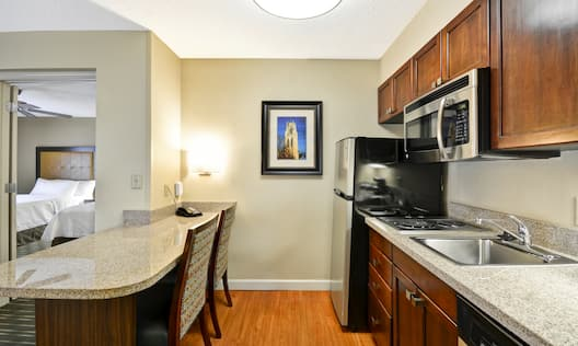 Guest Suite Kitchen Area with Microwave, Refridgerator and Dishwasher