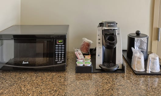 Close-Up of Microwave and Coffee Machine in Guestroom