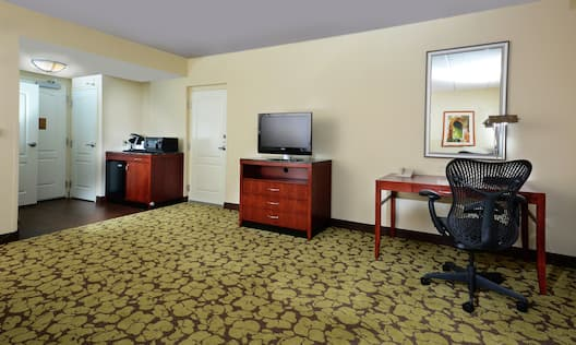 Accessible King Room Lounge Area with Work Desk, Television and Kitchenette