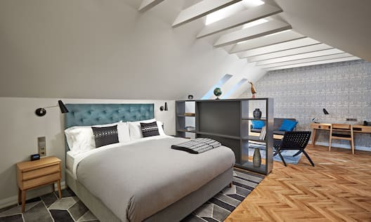 Loft Suite Bed and Lounge Area