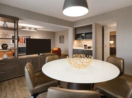 Seating area in suite, with TV