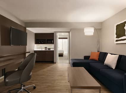 Lounge area in suite with comfortable seating and TV
