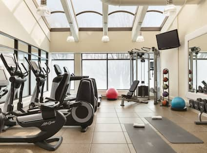 Fitness center with cardio machines and TV