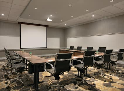 Meeting room with tables, chairs and projector