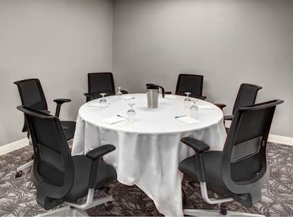 Small Meeting Room with round table and six chairs.