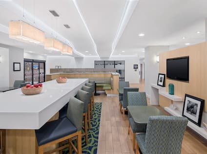 Lobby area with tables and chairs
