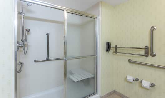 Accessible Guest Bathroom with Walk-In Shower, Bench and Handrails