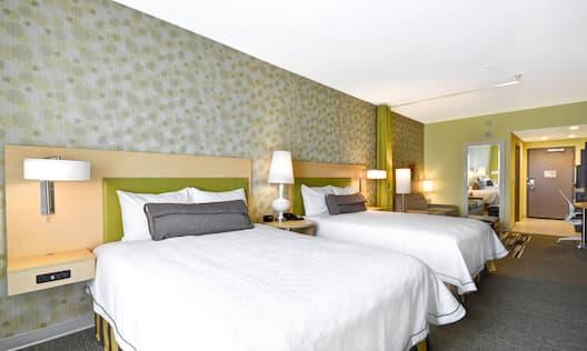 Two Queen Beds Guest Bedroom with Work Desk
