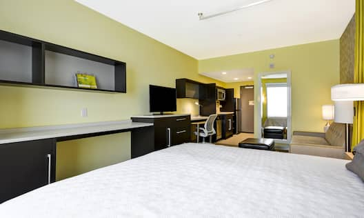 One King Bed Guest Bedroom with HDTV, Work Desk, Sofa and Footrest