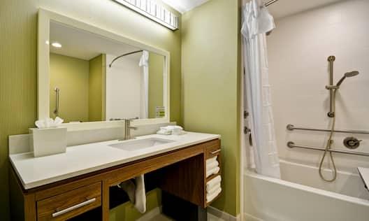 Guest Bathroom Vanity and Accessible Bath Tub