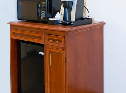 Accessible Hospitality Center With Mini Fridge, Keurig, and Ice Bucket on Microwave