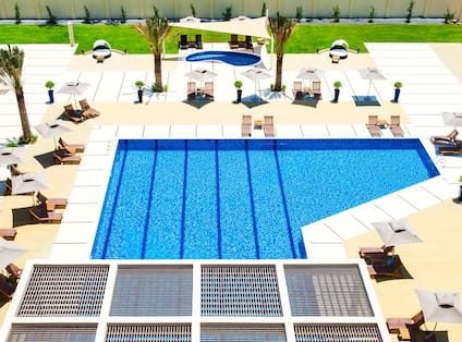 Aerial View of Outdoor Pool and Lounge Seating ona Sunny Day
