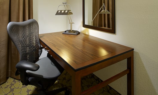 Guest Room Work Station With Wall Mirror, Illuminated Lamp, and Ergonomic Chair