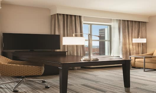 One King Bed Guest Suite with Sofa, Work Desk and TV