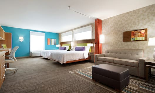 Two Queen Beds and Sofa Bed Seating Area