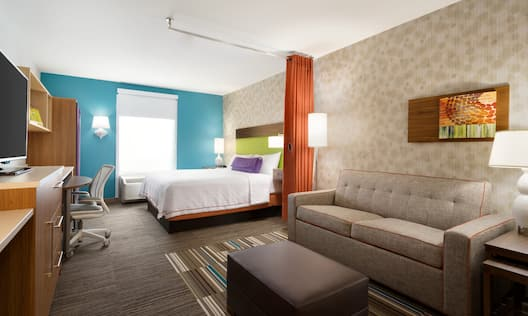 Studio Suite with King Bed and Sofa Bed Seating Area