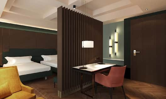 Guest Room with Two Double Beds and work desk