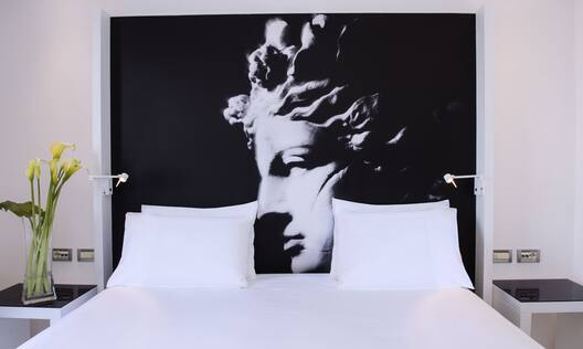 King Bed in Guestroom with Wall Art