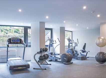 Fitness Center with Treadmills Recumbent Bike and Strength Equipment